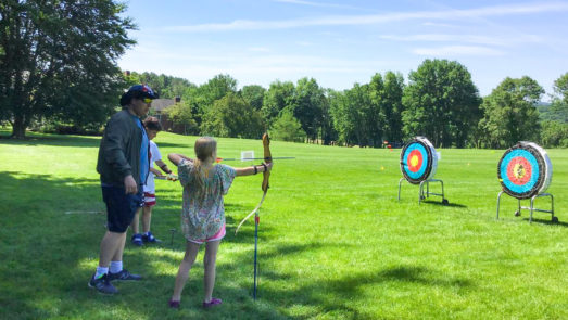 Campers on the archery field