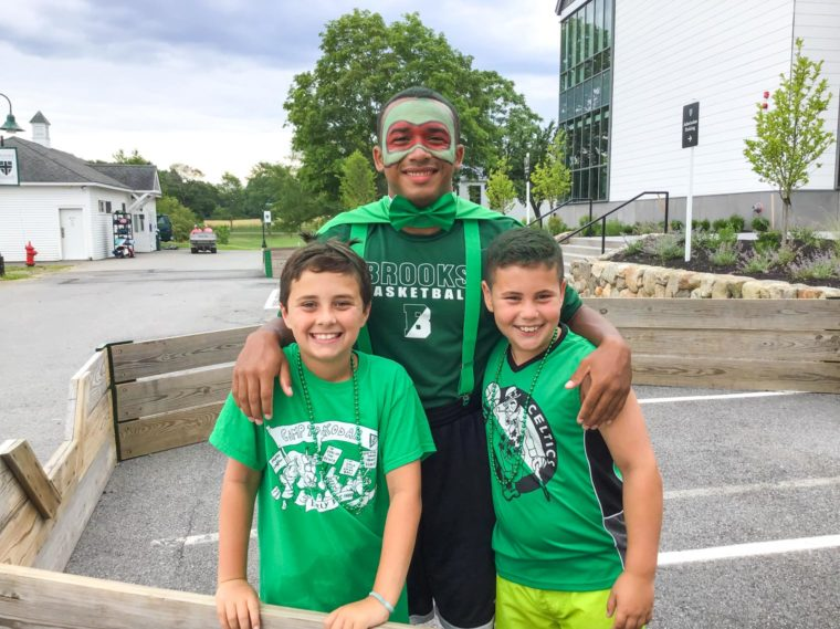 Two boys and their counselor dressed up in green