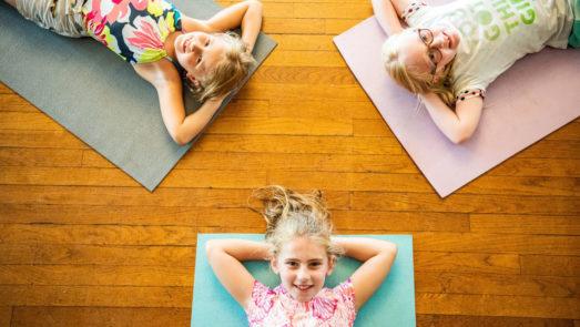Girls laying down on their yoga mats