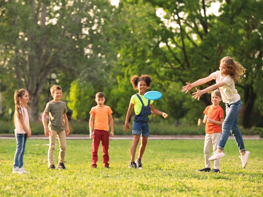 Kids playing frisbee outside